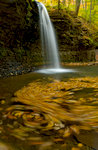 Waterfall Flowing Into Autumn Pond